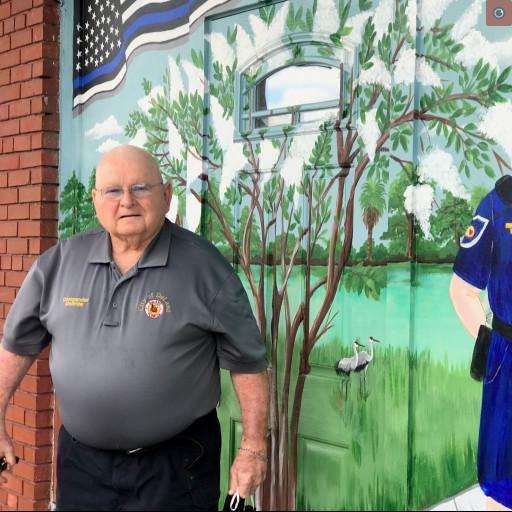 Mac McBride in front of his mural