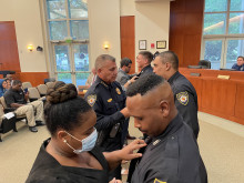 Police officers getting their badges